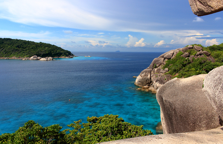 Beautiful tropical landscape with clear azure water and a blue sky on the Simian Islands, Thailand. View from the cliff of Sail to the calm Andaman sea without people.