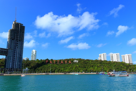 Bright urban seascape in summer day Pattaya city, Thailand. View of the city from the sea