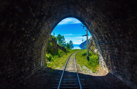 Light at the end of the tunnel on Circum-Baikal railway. Conceptual background representing hope, faith, endurance, perseverance, the desire to achieve the goal and exit from a difficult situation.