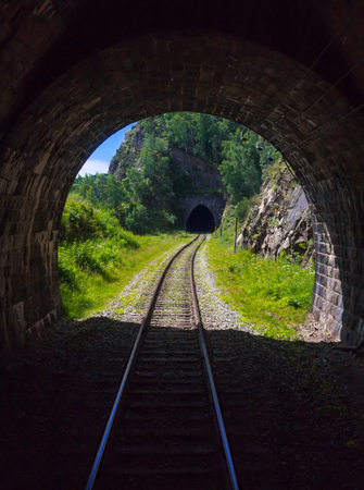 Two old stone mountains railway tunnels on the Circum-Baikal railway on the shore of Baikal as a section of the Trans-Siberian Railway