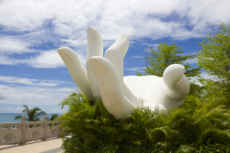 White sculpture - an open hand or palm in the Nanshan Buddhist Cultural Centre located near city of Sanya on Hainan island. Symbol of mercy and compassion