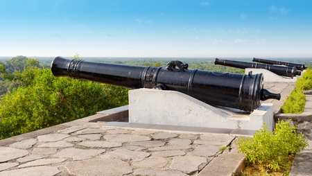 Summer landscape with old cannons on top of Bukit Melawati or Melawati Hill, Malaysia near Kuala Selangor town. Popular tourist attraction
