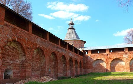 Fortress walls and Sentry Corner Tower of Zaraysk Kremlin. The inner territory of the Kremlin in spring sunny day. Cultural heritage of the Middle Ages 16th century in the Moscow region, Russia Stock Photo