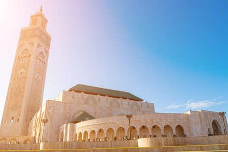 Casablanca, Morocco - 21 October, 2019: Blue sky and sunlit of Hassan II Mosque in Casablanca, Morocco.