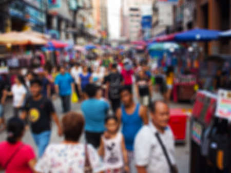 Defocused shot of crowd of people at the asian city. Concept blurred background in modern overcrowded metropolis 免版税图像