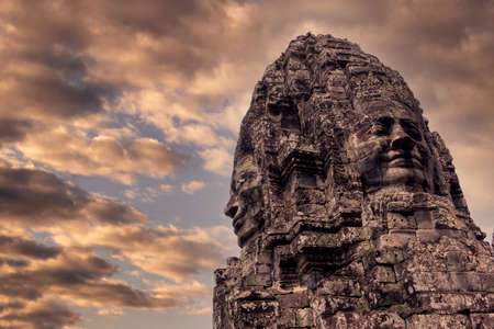 Buddha face at Bayon Temple in Angkor Wat complex in Siem Reap city, Cambodia. Stone carving of ancient Khmer architecture
