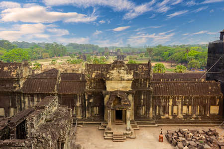 Perspective view on main complex of Angkor Wat, Siem Reap, Cambodia. Largest religious monument in the world. Khmer temple architecture Фото со стока