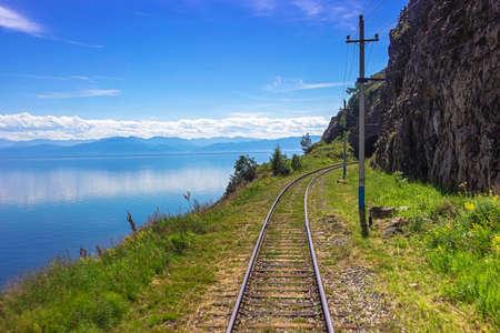 Trans Siberian railway on the coastline Baikal lake. Majestic summer landscape in the heart of Siberia, Russia Standard-Bild