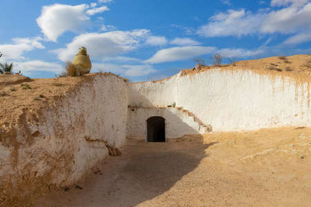 Traditional troglodyte cave-dwelling in Sahara desert in Tunisia. Cave house at Matmata