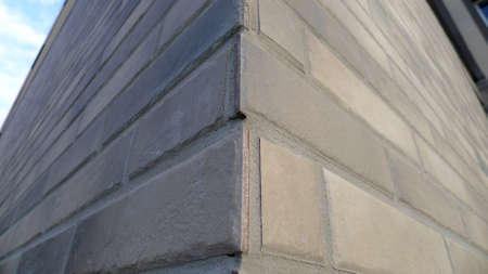 Finishing bricks in architecture, wall with trim tiles, outdoors Banque d'images - 142154864