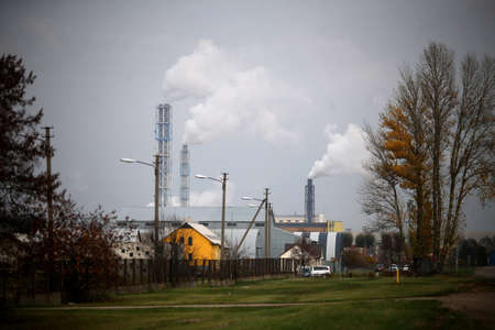 Factory with smoking chimneys in cloudy, Lithuania, Kedainiai