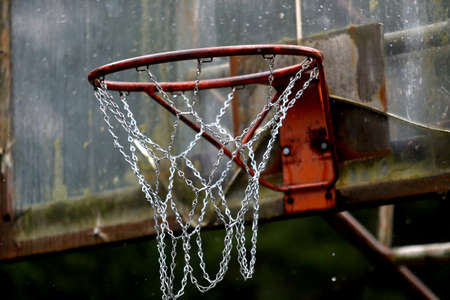 Outdoor basketball hoop and board damaged. It rains 스톡 콘텐츠
