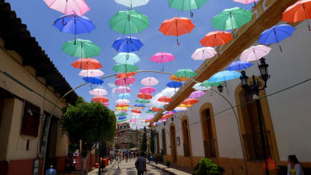 Colorful umbrellas background. Colorful umbrellas in the sky. Street decoration. Mexico