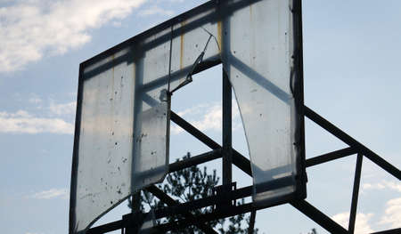 Outdoor Basketball Hoop in evening time.   Outdoor basketball hoop and board damaged. Nida Lithuania Stok Fotoğraf