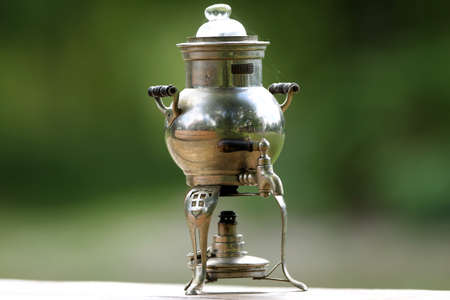 Antique Russian samovar on a wooden table
