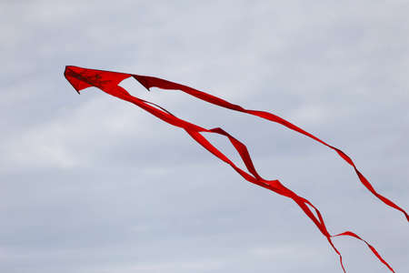 Various kites flying in the blue sky at the kite festival, Zapyskis, Lithuania