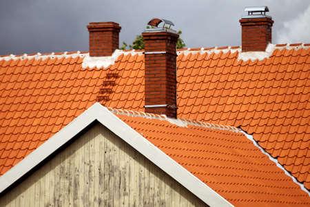 Red tiled roofs of Kuldiga old town buildings. Latvia Standard-Bild