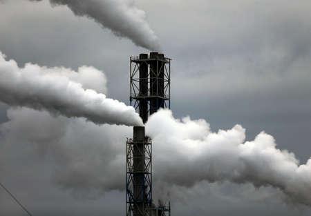 Factory with smoking chimneys in cloudy, Lithuania, Kedainiai