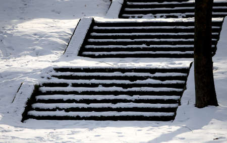 The stairs are covered with snow. Neatly. The problem of snow removal in the city. Not cleaned