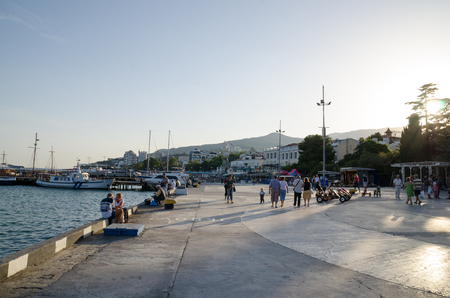 vacationers: Vacationers on the embankment. Yalta, Crimea