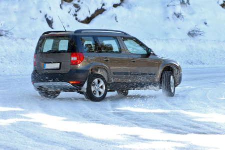 SUV in the snow Stock Photo