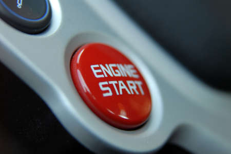 Start stop engine button on a modern sports car dashboard photo