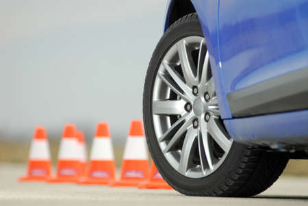 traffic cone: sport wheel photographed with red and white cones