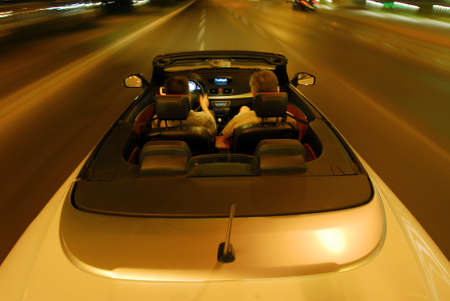 top down: night driving a convertible with the top down
