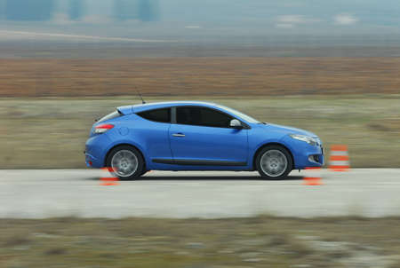 test drive: test drive a car at the test site with cones