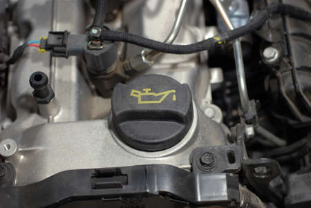Engine oil cap on a motor vehicle Stock Photo