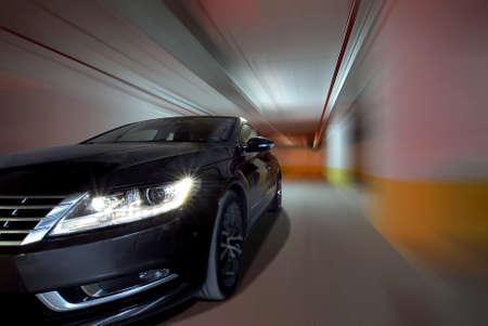 car driving fast through the underground garage