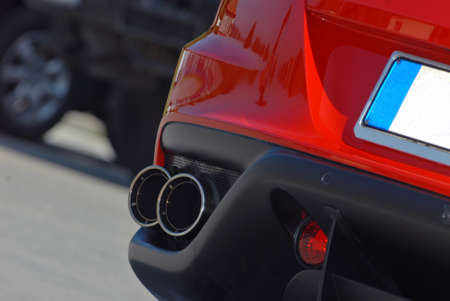 ends of the exhaust system on the sports car photo
