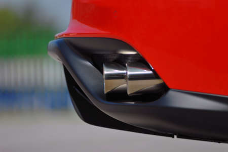 car exhaust: end of the muffler on the sports car
