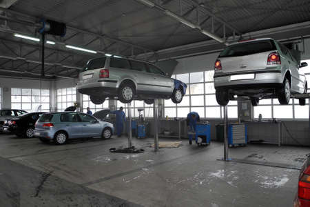 car shop: The car on the lift in a repair garage Editorial