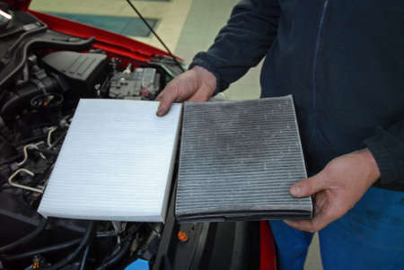 engine compartment: pollen filter new and old in the hands of masters