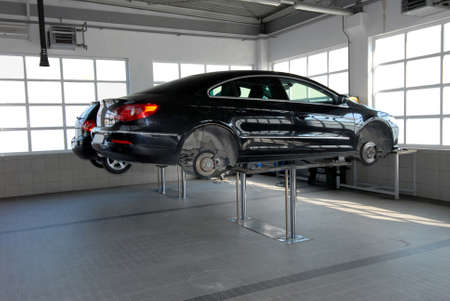 The car on the lift in a repair garage