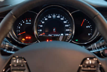 Closeup shot of a speedometer and tachometer of a modern car