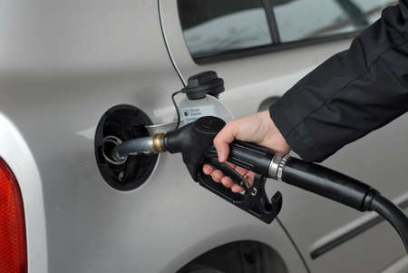 octane: Male hand refilling the car with fuel on a filling station
