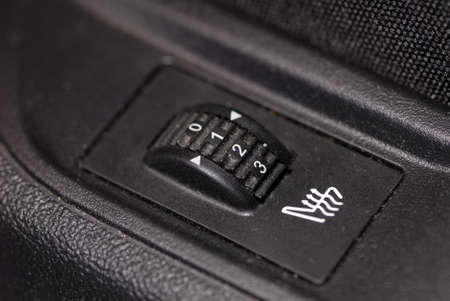 automotive seat with a rotary switch that regulates heating Banco de Imagens