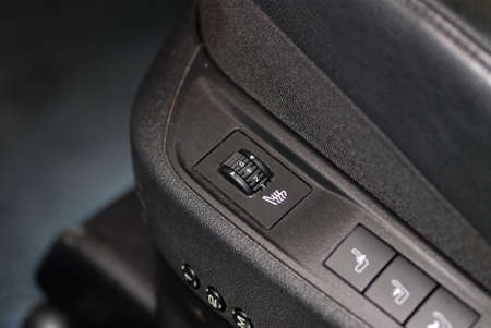 heated: automotive seat with a rotary switch that regulates heating Stock Photo