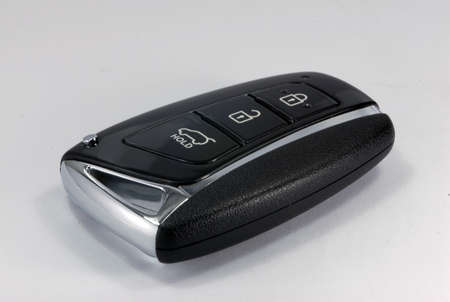 locking up: black car key with remote central locking