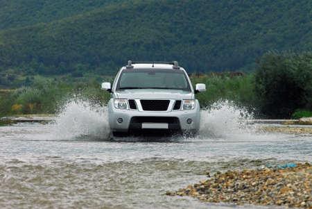 SUV crosses the river