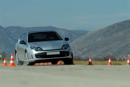braking distance: test drive a car at the test site with cones