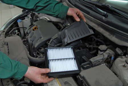 replacement of car air filter Stock Photo