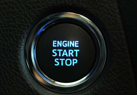 Car engine start and stop button photo