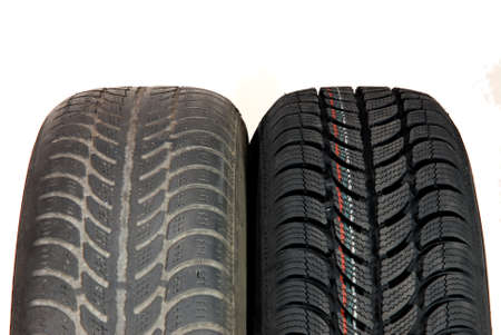 vulcanization: old and new winter car tires Stock Photo