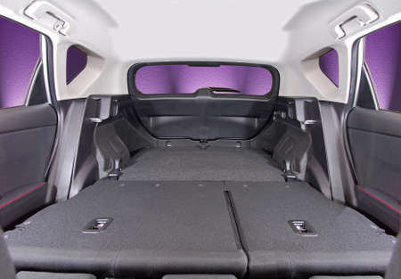 car trunk: car trunk with rear seats folded, inside view Stock Photo