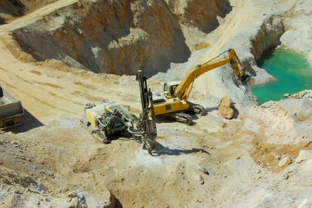 heavy machinery working in a quarry photo