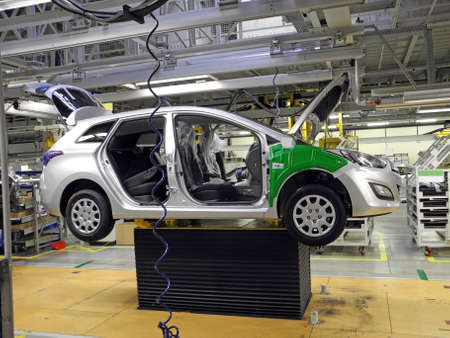 new motor cars: car production line Editorial