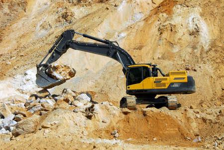 power shovel: Yellow loader, dredge